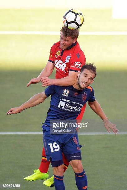 Johan Absalonsen of United and Jack Hingert of the Roar compete for the ball during the round 13 ALeague match between Adelaide United and Brisbane...