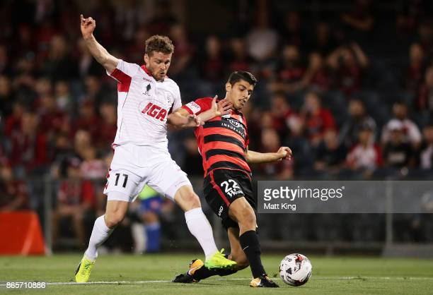 Johan Absalonsen of United beats Jonathan Aspropotamitis of the Wanderers to score the first goal during the FFA Cup Semi Final match between the...