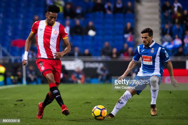 Johan Andres Mojica of Girona FC plays the ball past Pablo Piatti of RCD Espanyol during the La Liga match between RCD Espanyol and Girona FC at RCDE...