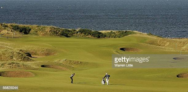Johan Axgren of Sweden plays his second shot into the fourth green during first round of the Dunhill Links Championship at Kingsbarns Colf Club on...