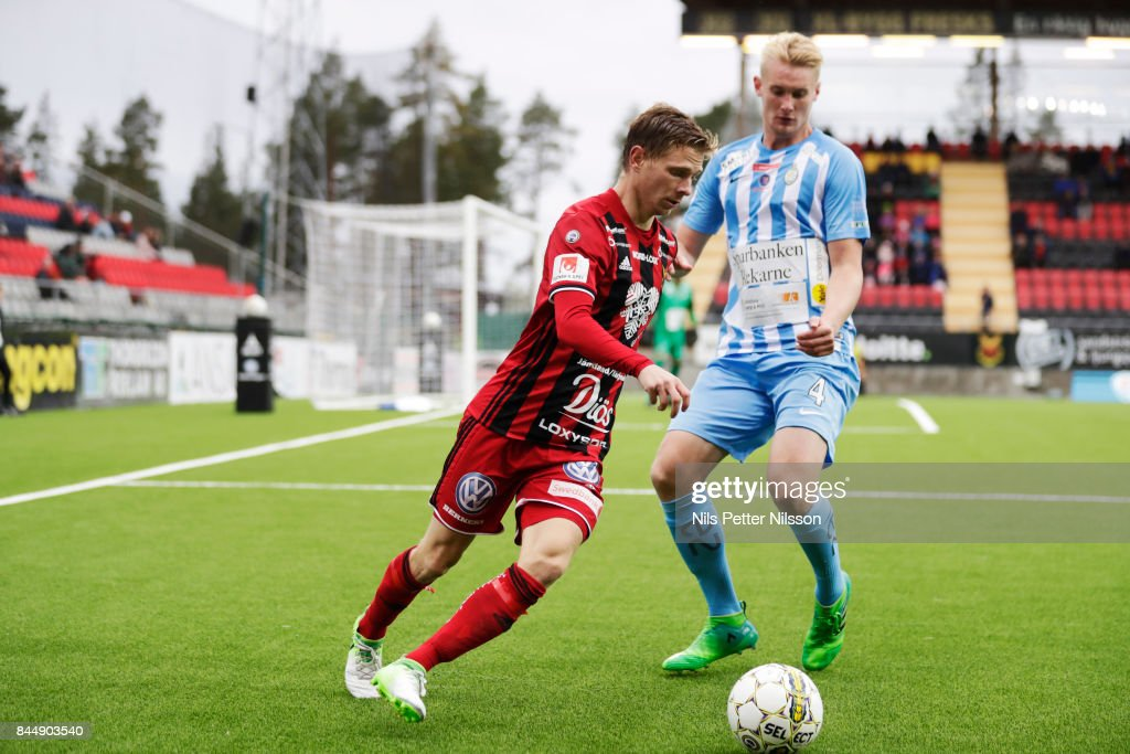 Johan Bertilsson of Oestersunds FK and Ludvig Ohman Silwerfeldt of Athletic FC Eskilstuna competes for the ball during the Allsvenskan match between Ostersunds FK and Athletic FC Eskilstuna at Jamtkraft Arena on September 9, 2017 in Ostersund, Sweden.