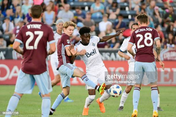 Johan Blomberg of Colorado Rapids and Alphonso Davies of Vancouver Whitecaps compete for possession at Dick's Sporting Goods Park on June 1 2018 in...
