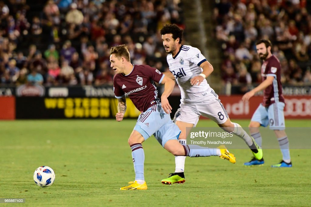 Johan Blomberg #8 of Colorado Rapids dribbles past Felipe Martins #8 of Vancouver Whitecaps at Dick's Sporting Goods Park on June 1, 2018 in Commerce City, Colorado.