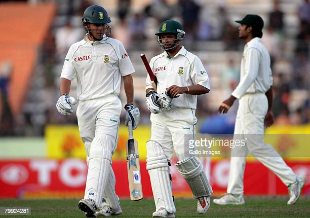 Johan Botha and Ashwell Prince of South Africa walk off the pitch with 76/4 on the scoreboard during day one of the First Test match between...