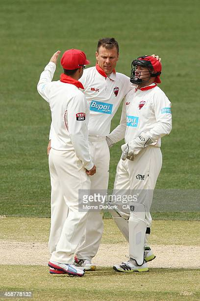 Johan Botha and Tim Ludeman of the SA Redbacks celebrate after they dismissed Scott Henry of the NSW Blues during day four of the Sheffield Shield...