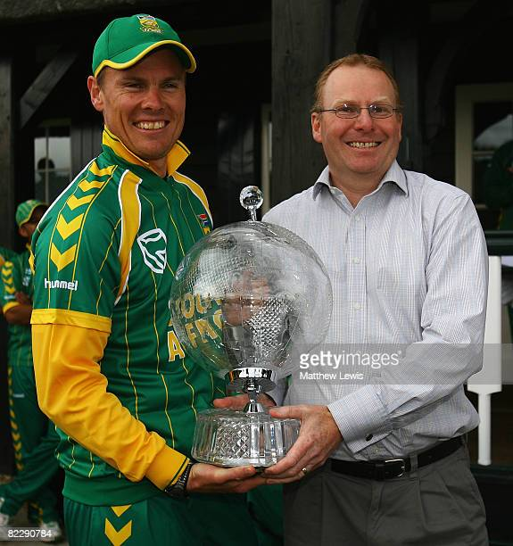 Johan Botha Captain of South Africa is presented with the 'Sodexho' Trophy after defeating the PCA Masters during the Twenty20 match between the PCA...