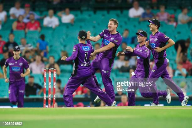 Johan Botha of the Hurricanes celebrates catching out Daniel Hughes of the Sixers off the bowling of James Faulkner during the BBL match between the...