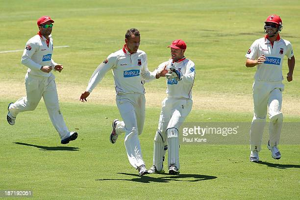 Johan Botha of the Redbacks celebrates the wicket of John Rogers of the Warriors during day two of the Sheffield Shield match between the Western...