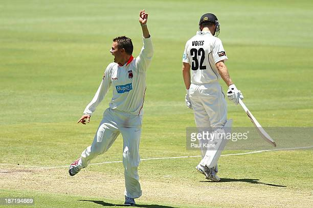 Johan Botha of the Redbacks celebrates the wicket of Will Bosisto of the Warriors during day two of the Sheffield Shield match between the Western...