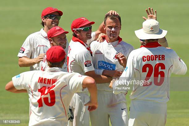 Johan Botha of the Redbacks is congratulated by team mates after dismissing Mitchell Marsh of the Warriors during day four of the Sheffield Shield...