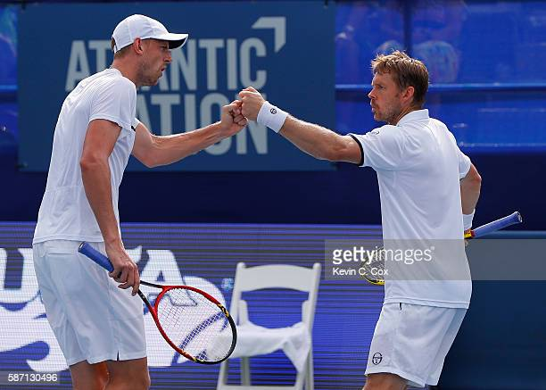 Johan Brunstrom and Andreas Siljestrom of Sweden react in the match against Horacio Zeballos and Andres Molteni of Argentina during the finals of the...
