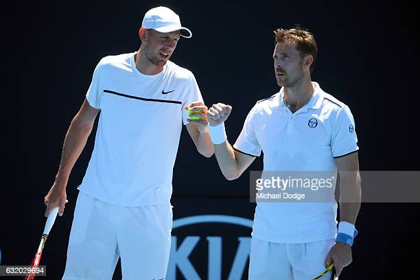 Johan Brunstrom of Sweden and Andreas Siljestrom of Sweden talk tactics during their first round match against Marcelo Melo of Brazi and Lukas Kubot...