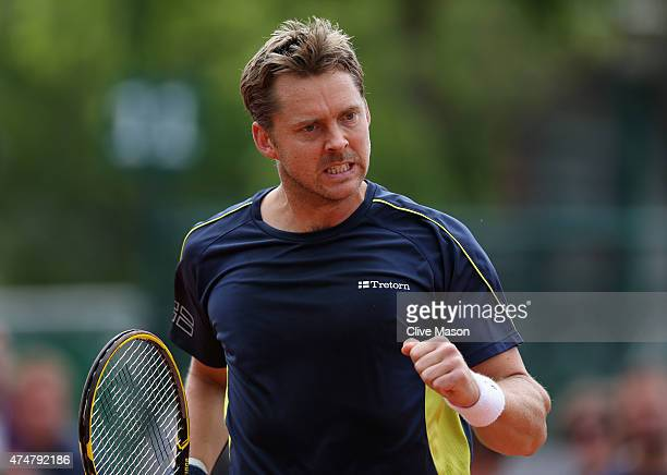 Johan Brunstrom of Sweden celebrates a point in his Men's Doubles match with Mikhail Kukushkin of Kazakhstan against Andrey Golubev of Kazakhstan and...