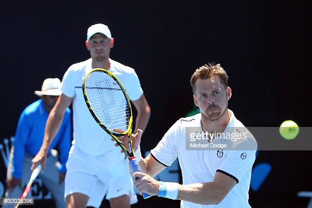 Johan Brunstrom of Sweden competes with Andreas Siljestrom of Sweden during their first round match against Marcelo Melo of Brazi and Lukas Kubot of...