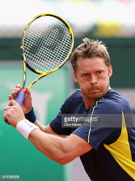 Johan Brunstrom of Sweden in action in his Men's Singles match against Andrey Golubev of Kazakhtan on day three of the 2015 French Open at Roland...