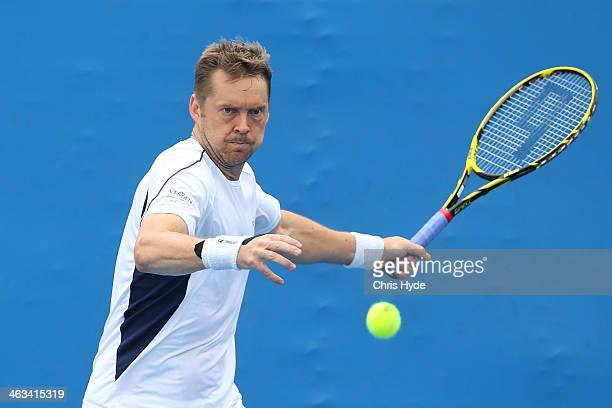 Johan Brunstrom of Sweden plays a forehand in his second round doubles match with Frederik Nielsen of Denmark against Julien Benneteau of France and...