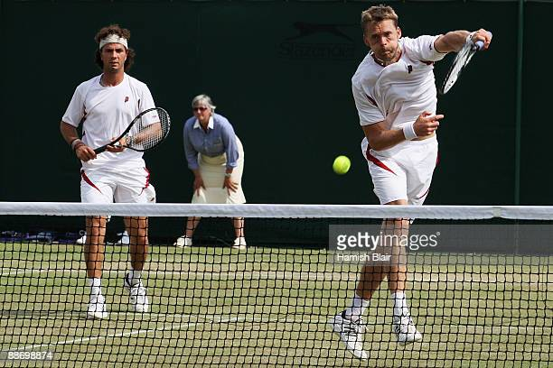 Johan Brunstrom of Sweden plays a forehand playing with JeanJulien Rojer of Netherlands Antilles during the men's doubles second round match against...