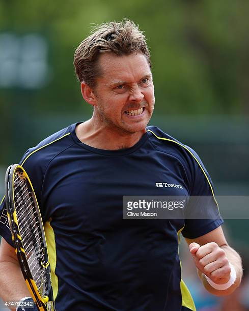 Johan Brunstrom of Swedencelebrates a point in his Men's Doubles match with Mikhail Kukushkin of Kazakhstan against Andrey Golubev of Kazakhstan and...