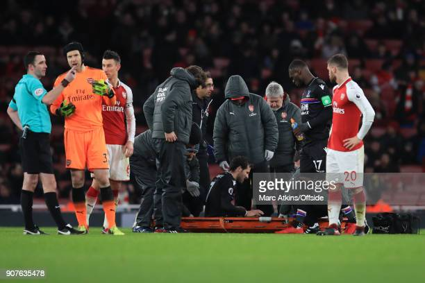 Johan Cabaye of Crystal Palace is placed onto a stretcher before being carried off with an injury during the Premier League match between Arsenal and...