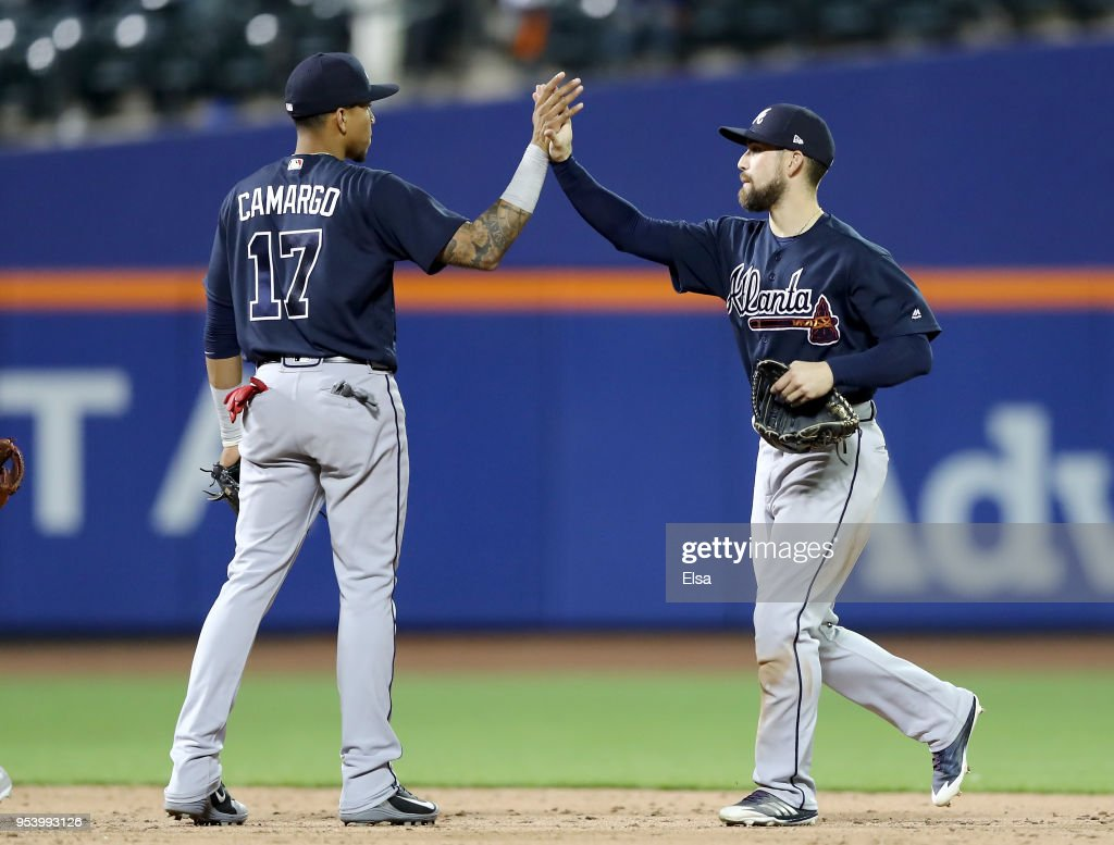 Johan Camargo #17 and Ender Inciarte #11 of the Atlanta Braves celebrate the 7-0 win over the New York Mets on May 2, 2018 at Citi Field in the Flushing neighborhood of the Queens borough of New York City.