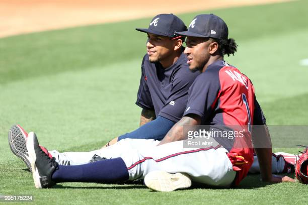 Johan Camargo and Ozzie Albies of the Atlanta Braves look on before the game against the Los Angeles Dodgers at Dodger Stadium on June 9 2018 in Los...