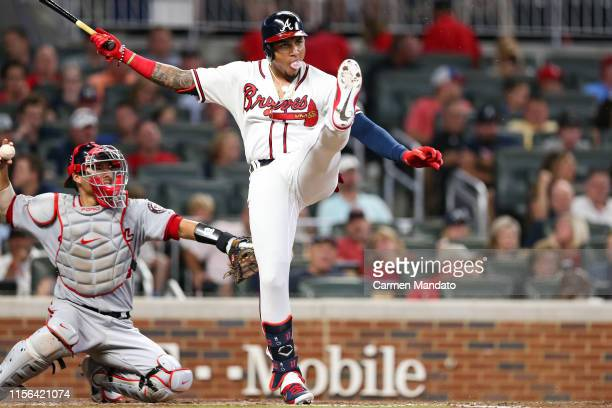 Johan Camargo of the Atlanta Braves bats in the fifth inning during the game against the Washington Nationals at SunTrust Park on July 18 2019 in...