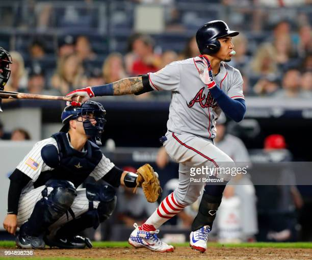 Johan Camargo of the Atlanta Braves blows a bubble with his bubble gum as he hits a single in an interleague MLB baseball game against the New York...