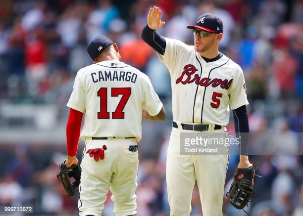 Johan Camargo of the Atlanta Braves celebrates with Freddie Freeman at the conclusion of an MLB game against the Arizona Diamondbacks at SunTrust...