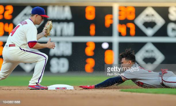 Johan Camargo of the Atlanta Braves dives safely into second with a double before Scott Kingery of the Philadelphia Phillies can make the tag during...