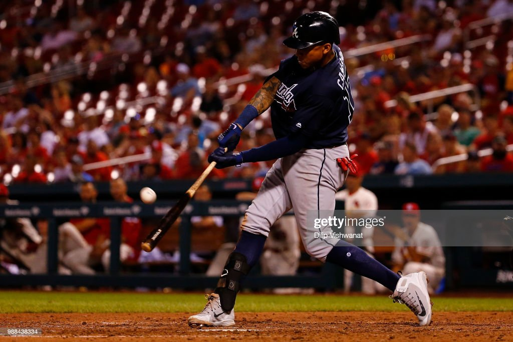 Johan Camargo #17 of the Atlanta Braves drives in a run with a sacrifice fly ball against the St. Louis Cardinals in the ninth inning at Busch Stadium on June 30, 2018 in St. Louis, Missouri.