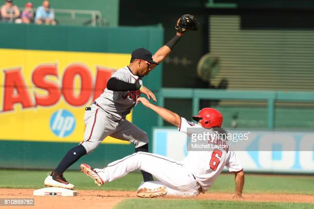 Johan Camargo of the Atlanta Braves forces out Anthony Rendon of the Washington Nationals at second base on Adam Lind ground ball in the forth inning...
