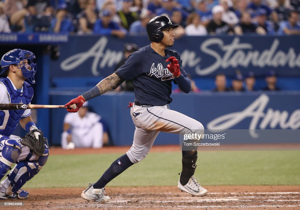 Johan Camargo #17 of the Atlanta Braves hits a double in the eighth inning during MLB game action against the Toronto Blue Jays at Rogers Centre on June 19, 2018 in Toronto, Canada.