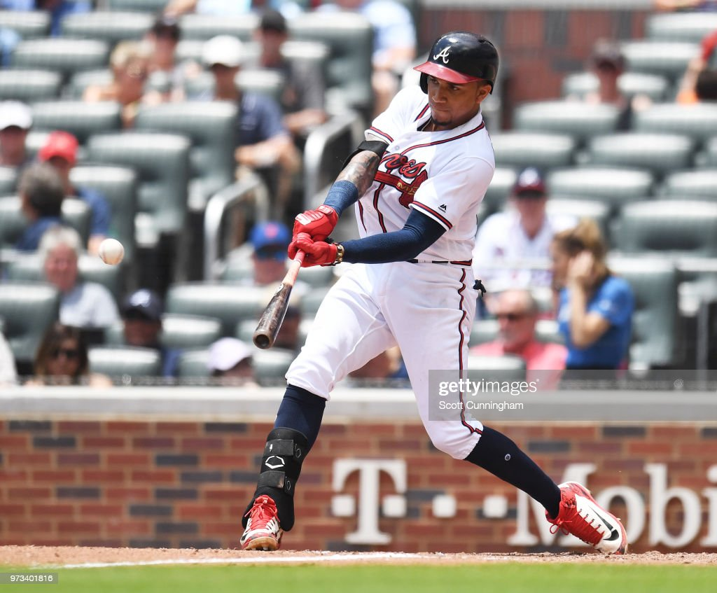 Johan Camargo #17 of the Atlanta Braves hits a seventh inning double against the New York Mets at SunTrust Field on June 13, 2018 in Atlanta, Georgia.