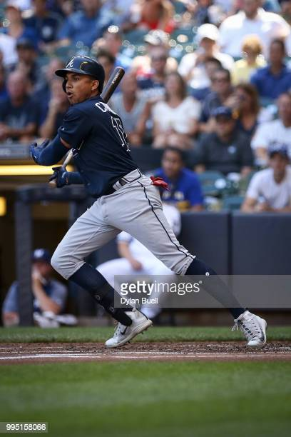 Johan Camargo of the Atlanta Braves hits a single in the first inning against the Milwaukee Brewers at Miller Park on July 7 2018 in Milwaukee...