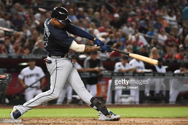 Johan Camargo of the Atlanta Braves hits a solo home run in the third inning of the MLB game against the Arizona Diamondbacks at Chase Field on...