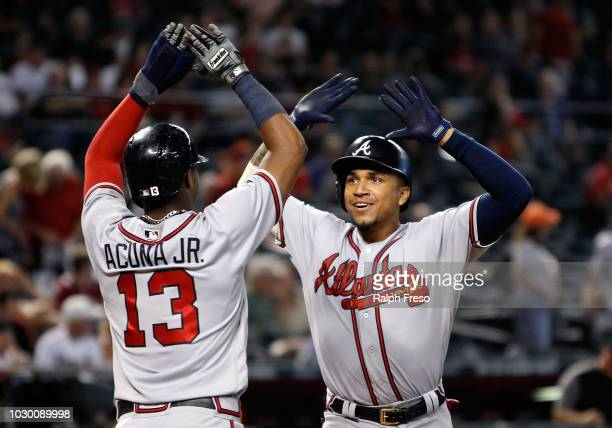 Johan Camargo of the Atlanta Braves is congratulated by teammate Ronald Acuna Jr #13 after hitting a tworun home run against the Arizona Diamondbacks...