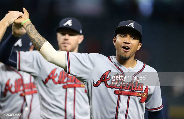 Johan Camargo of the Atlanta Braves is congratulated by teammates after a 95 victory against the Arizona Diamondbacks during an MLB game at Chase...