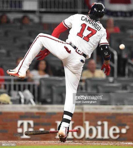Johan Camargo of the Atlanta Braves is hit by a pitch during the third inning against the New York Mets at SunTrust Field on May 28 2018 in Atlanta...