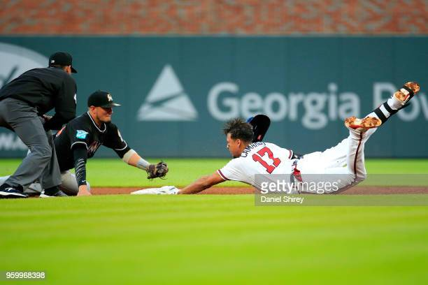 Johan Camargo of the Atlanta Braves is tagged out at second by Miguel Rojas of the Miami Marlins during the third inning at SunTrust Park on May 18...