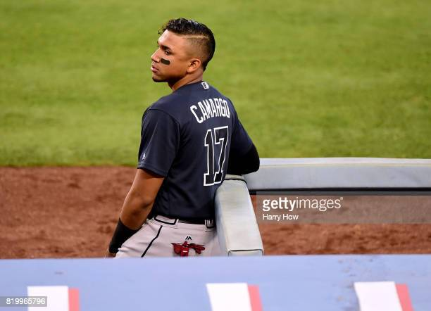 Johan Camargo of the Atlanta Braves looks on from the dugout during the game against the Los Angeles Dodgers at Dodger Stadium on July 20 2017 in Los...