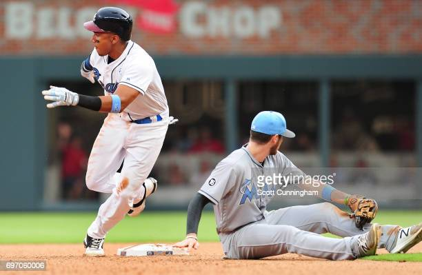Johan Camargo of the Atlanta Braves looks to advance on a tenth inning fielders choice against J. T. Riddle of the Miami Marlins at SunTrust Park on...