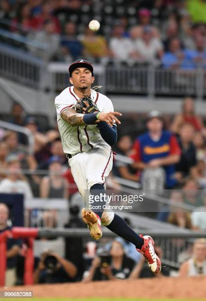 Johan Camargo of the Atlanta Braves makes a throw to first base for the final out of the game against the Toronto Blue Jays at SunTrust Park on July...