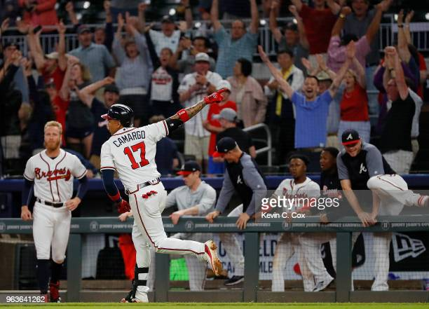Johan Camargo of the Atlanta Braves reacts after hitting a walkoff homer in the ninth inning of a 76 win over the New York Mets at SunTrust Park on...