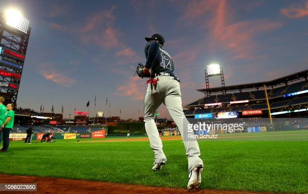 Johan Camargo of the Atlanta Braves run onto the field before a game against the Philadelphia Phillies at Citizens Bank Park on September 28 2018 in...