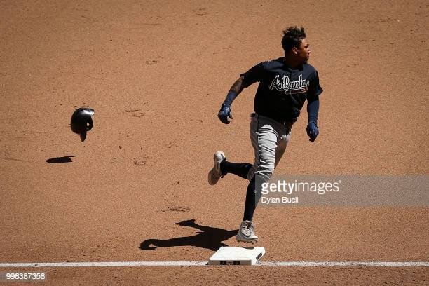 Johan Camargo of the Atlanta Braves runs to third base in the sixth inning against the Milwaukee Brewers at Miller Park on July 8 2018 in Milwaukee...