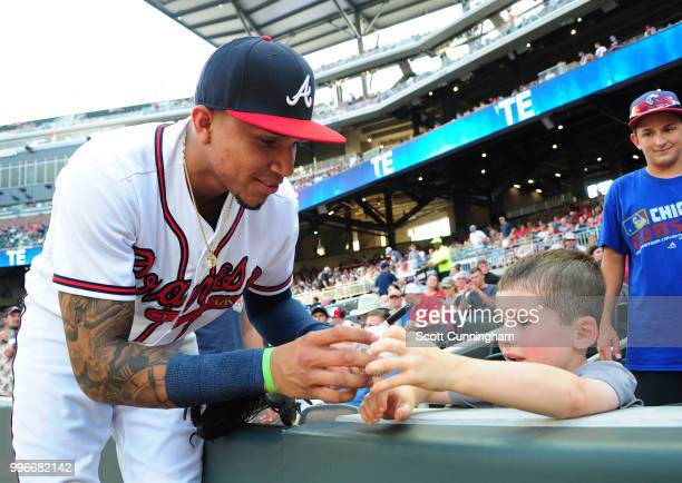 Johan Camargo of the Atlanta Braves signs an autograph before the game against the Toronto Blue Jays at SunTrust Park on July 11 2018 in Atlanta...