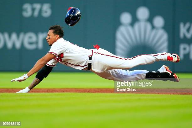 Johan Camargo of the Atlanta Braves slides into second during the third inning against the Miami Marlins at SunTrust Park on May 18 2018 in Atlanta...