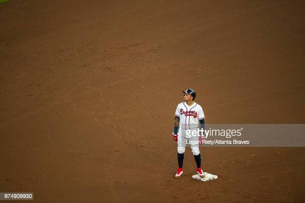 Johan Camargo of the Atlanta Braves stands on second base during the game against the New York Mets at SunTrust Park on June 12 2018 in Atlanta...