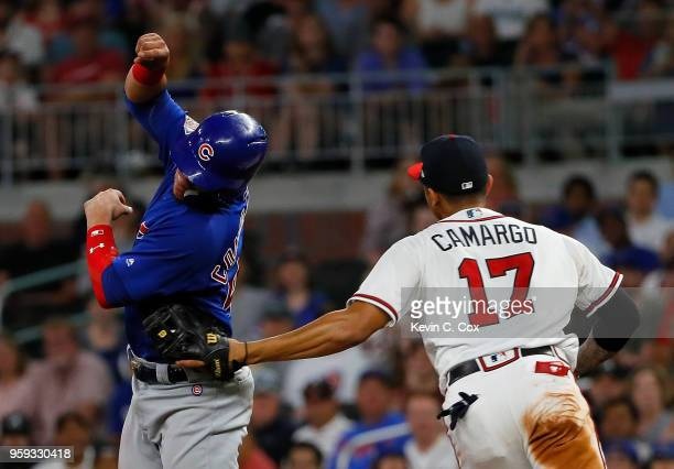 Johan Camargo of the Atlanta Braves tags out Willson Contreras of the Chicago Cubs on a double play hit into by Kyle Schwarber in the sixth inning at...