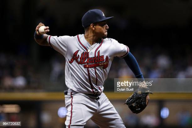 Johan Camargo of the Atlanta Braves throws to first base in the eighth inning against the Milwaukee Brewers at Miller Park on July 6 2018 in...